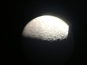 Photo of the moon's surface taken via an iPhone through a telescope.